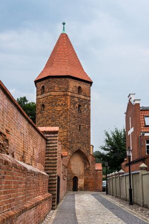 loopholes: Gothic fortification tower in Lebork, Poland