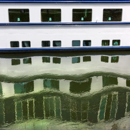 Rhythm of ship windows with their water reflections  Natural pattern  photo