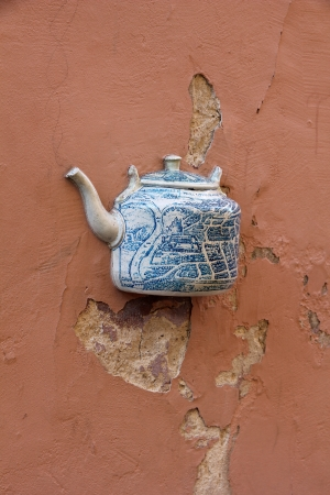embed: A teapot, one of the teapots set embedded in facade of old building in Vilnius, Lithuania Stock Photo