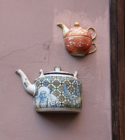 embed: Teapots embedded in facade of old building in Vilnius, Lithuania.