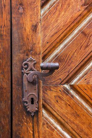 Ancient door handle on old door in Cesky Krumlov, Czech Republic. Stock Photo - 16951149