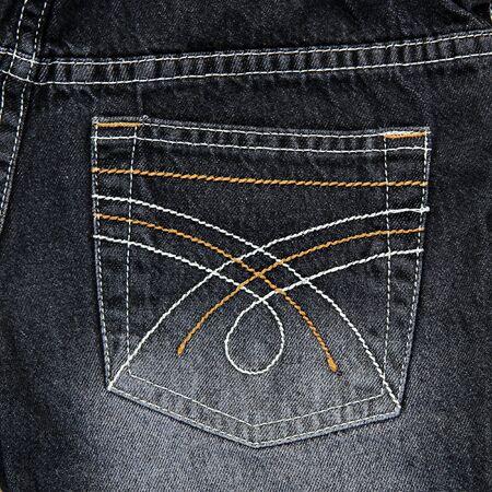 Jeans pocket. Fragment of black jeans. photo