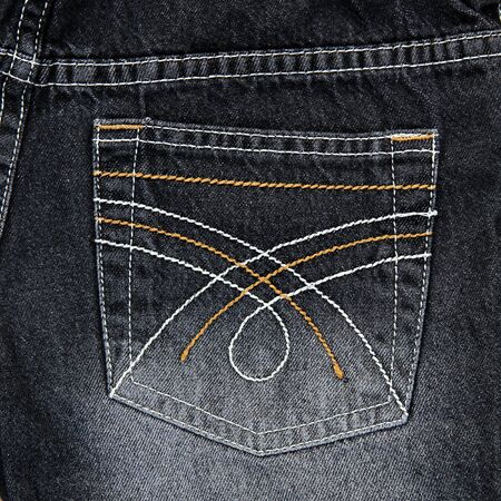 cloth back: Jeans pocket. Fragment of black jeans.