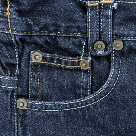 Jeans pocket. Fragment of blue jeans. photo