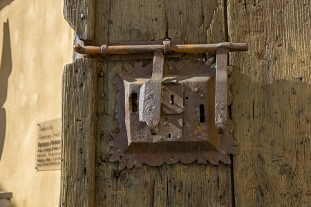Ancient iron lock with latch on aged boarded door in Bamberg, Germany Stock Photo - 23016059