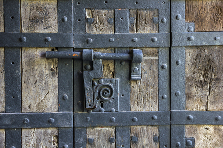 boarded: Ancient iron lock with latch on aged boarded door in Wurzburg, Germany  Stock Photo