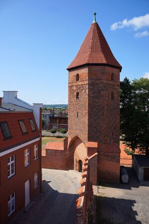 loopholes: Gothic fortification tower in Lembork, Poland       Stock Photo