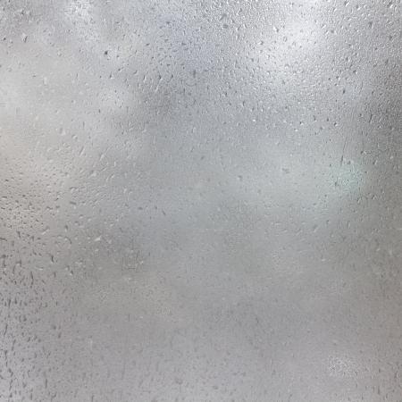 Texture de gouttes congelées sur le verre dépoli. Résumé hiver texturé. Banque d'images