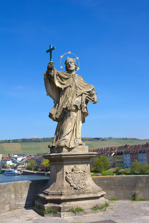 alte: Statue of St John of Nepomuk on Old bridge  Alte Mainbruecke  in Wurzburg, Germany  Editorial