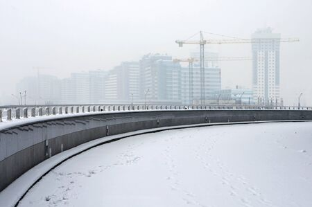 housing development: Housing development. Construction site in winter fog. Minsk, Belarus.