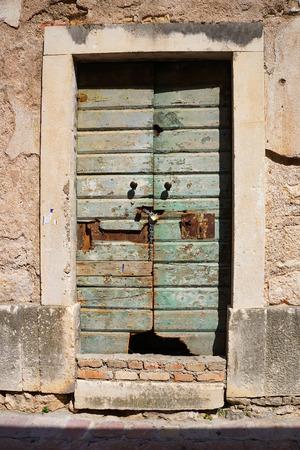 ramshackle: Old timeworn shabby doors in Kotor, Montenegro. Stock Photo