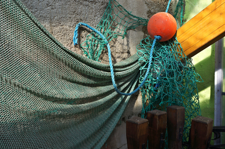 holed: Fishing net on a wall.