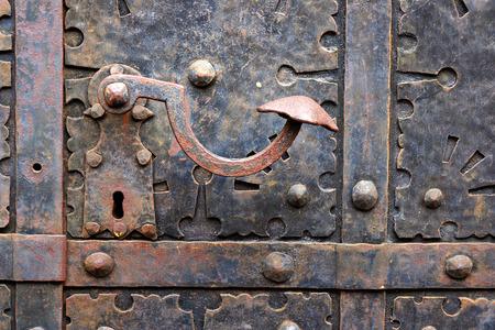 doorhandle: Ancient iron door handle on iron medieval door in Gdansk, Poland. Stock Photo