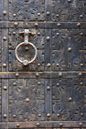 clincher: Ancient iron door handle on iron medieval door in Gdansk, Poland. Stock Photo