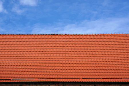 architectural exteriors: Red tiled roof and blue sky background.
