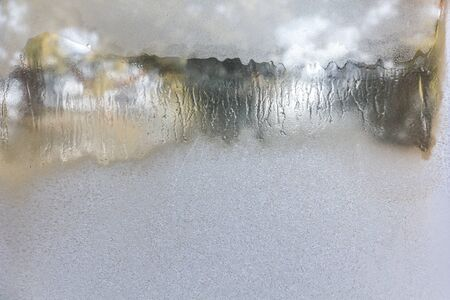 Texture of frozen drops on frosted glass. Winter textured background.