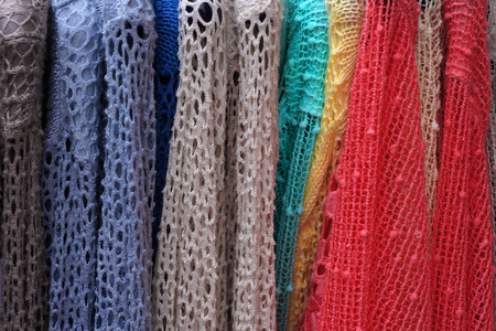 garment: Colorful  lacy pullovers on hangers. Ladies wear Stock Photo