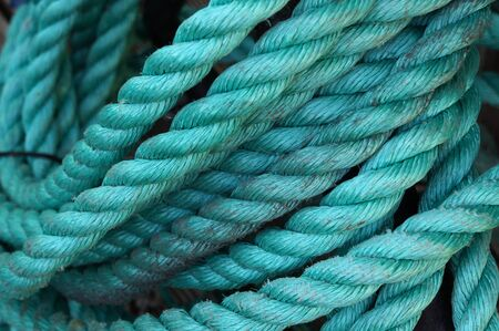 twisted: Hank of twisted turquoise rope.