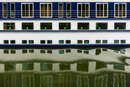 danubian: Pattern of ship windows with their reflections in water.