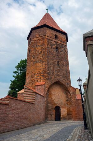 loopholes: Gothic medieval fortification tower in Lembork, Poland.