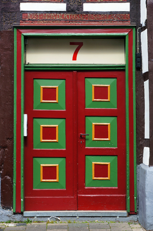 entry numbers: A front door of medieval building in Hameln, Germany.