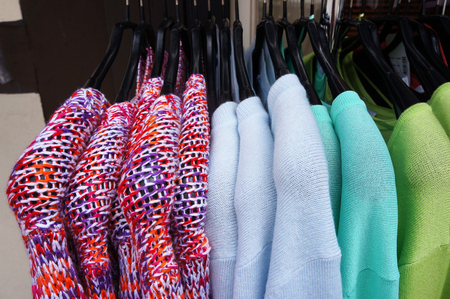hangers: Color pullovers on hangers.