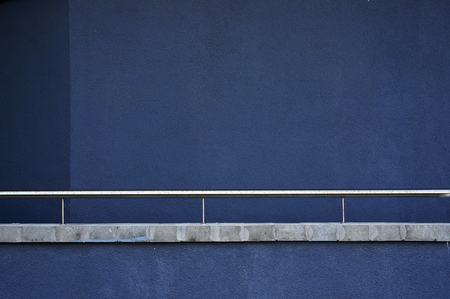 parget: Blue wall and metal railing. Abstract architectural background. Stock Photo