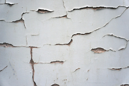 damaged: Damaged cracked old wall texture.