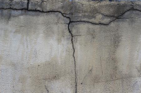 damaged: Damaged cracked old wall. Stock Photo