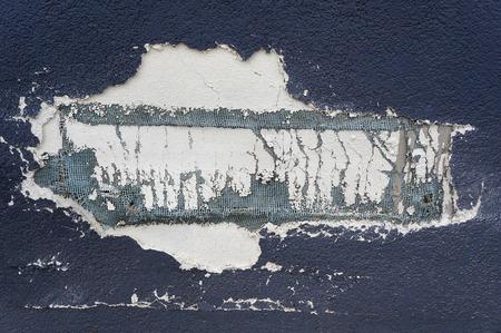 damaged: Damaged wall layers decay closeup.