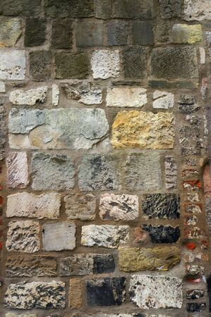 aging: Stone and brick wall. Architectural textured background.