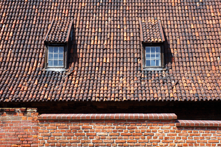 Old tiled roof with dormers in Gdansk, Poland.