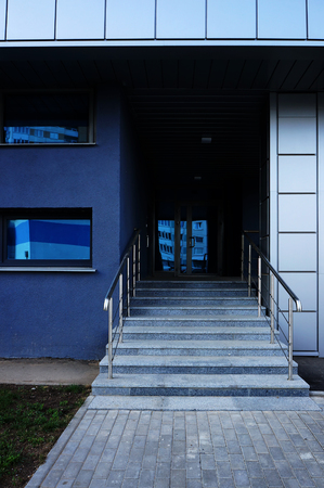 Stairs to entrance in modern building.