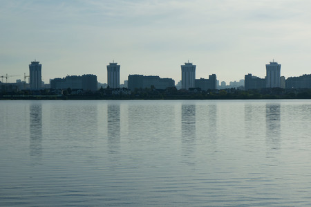 Silhouette of modern district on on the river bank. Stock Photo