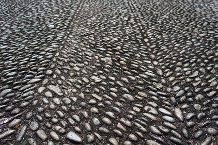 Pebble pavement on Funchal streets, Madeira, Portugal.