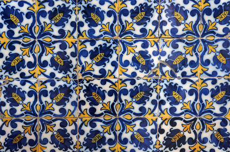 Traditional portuguese ceramic tiles on wall of old building in Funchal, Madeira, Portugal. Stock Photo