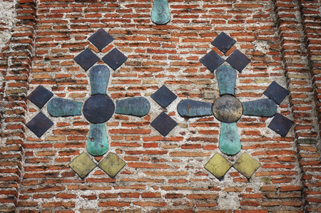 Ancient brick wall of The Kalozha church of Sts. Boris and Gleb in Grodno, Belarus, that was built in 12th century. Facade is decorated with majolica tiles.
