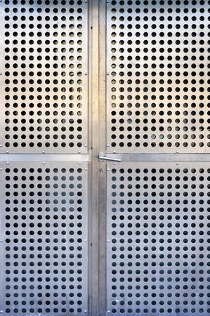 Modern metal doors. Perforated steel. 写真素材