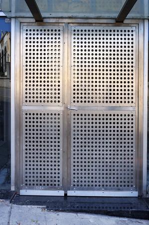 Entrance in modern building. Metal doors of perforated steel. 写真素材