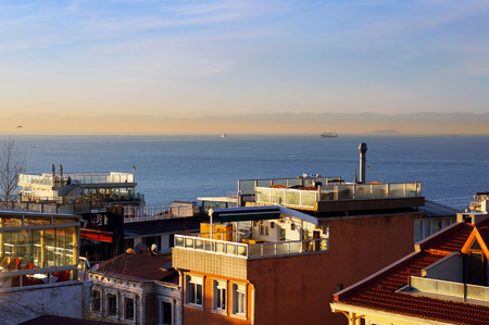 Terraces on roofs of houses. View to Bosphorus Strait. Istanbul, Turkey.