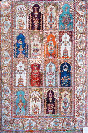 Traditional Turkish carpet. Ornamental pattern with floral and architectural motifs. Stock Photo