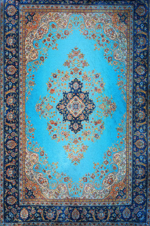 Traditional Turkish carpet. Ornamental floral pattern.