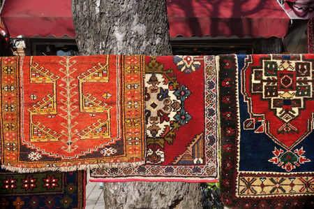 Traditional Turkish carpets hanging on the street in Istanbul, Turkey. Stock Photo