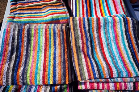 Striped towels on retail sale at the market.