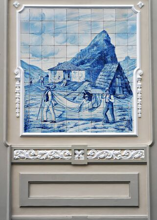 Funchal, Madeira, Portugal - June 14, 2017: Traditional portuguese ceramic tiles azulejos on wall of old building in Funchal, Madeira, Portugal. Redakční