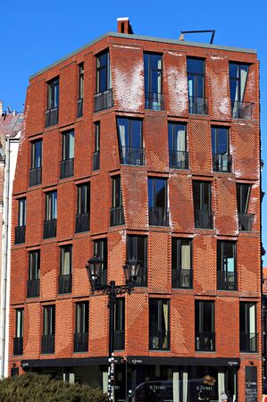 Riga, Latvia - March 28, 2018: Facade of modern building located in old town of Riga.