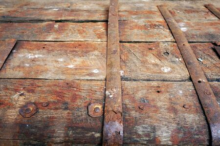Rusty metal surface of old ancient kist. Iron-bound wooden coffer.