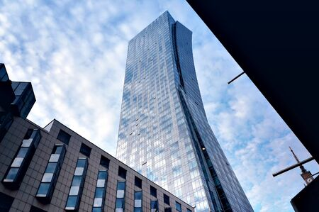 Warsaw, Poland - August 20, 2019: Exterior of modern tower building in downtown of Warsaw, Poland.