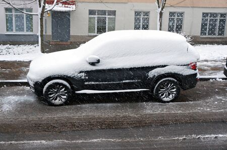 Minsk, Belarus - December 27, 2019: Snow on car after snowfall. Winter urban scene.