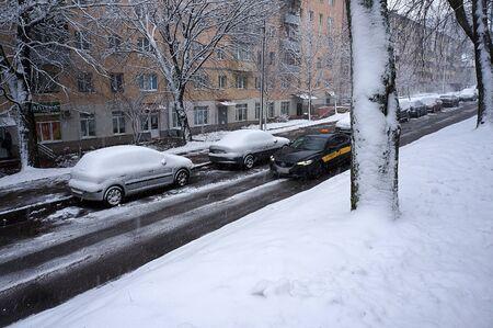 Minsk, Belarus - December 27, 2019: Street during snowfall. Winter urban scene.
